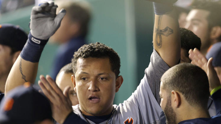 Detroit Tigers' Miguel Cabrera celebrates with teammates after his solo home run in the sixth inning of a baseball game against the Kansas City Royals at Kauffman Stadium in Kansas City, Mo., Monday, Oct. 1, 2012. (AP Photo/Orlin Wagner)