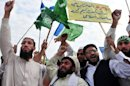 Activists of Jamaat-e-Islami Pakistan shout slogans during a protest against US pressure against the Haqqani network