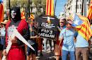 Participants march with a mock-up of a coffin bearing the lettering 'Catalan country' during a demonstration in Perpignan, southern France, on September 10, 2016