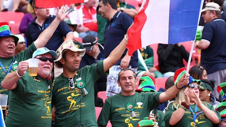 French fans attend the first round match between France and Fiji at the IRB Sevens rugby tournament at the Nelson Mandela Bay Stadium in Port Elizabeth on December 7, 2013