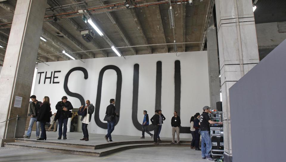 Members of the media are gathered in the lobby of the Palais de Tokyo in Paris, Thursday, April 12, 2012.  After six months of works, this museum devoted to contemporary art will reopen to the public on April 20. (AP Photo/Remy de la Mauviniere)