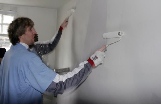 FILE - In this Feb. 15, 2008 file photo, Dallas Mavericks basketball star Dirk Nowitzki, of Germany, paints a wall in a home in the Lower 9th ward of New Orleans. This week marks six years since NBA A