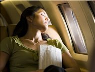 sleeping woman on plane