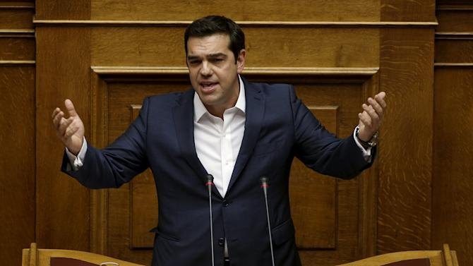 Greek PM Tsipras delivers a speech during a parliamentary session before a vote of confidence at the parliament building in Athens