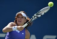 Agnieszka Radwanska of Poland hits a forehand against Jelena Jankovic of Serbia during their 2012 US Open women&#39;s singles match at the USTA Billie Jean King National Tennis Center in New York. Radwanska won 6-3, 7-5