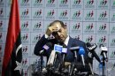 Jibril, head of the National Forces Alliance, wipes perspiration from his brow during a news conference at his party's headquarters in Tripoli