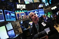 Traders work on the floor of the New York Stock Exchange on January 2, 2013 in New York City. World markets soared Wednesday after a tense New Year break, relieved after US lawmakers agreed a last-minute deal to avert massive tax hikes and pull their nation back from the fiscal cliff