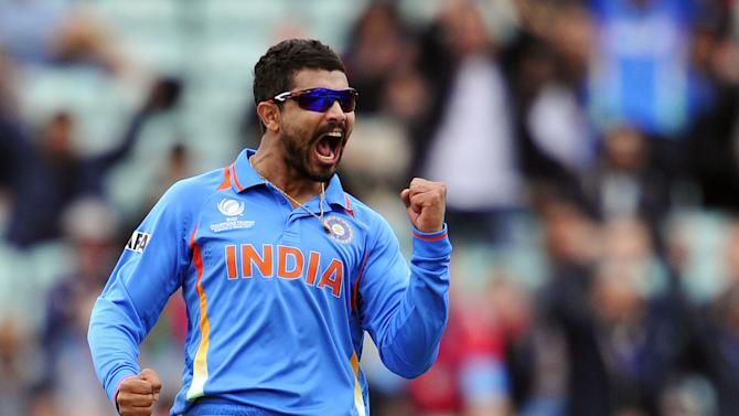 India's Ravindra Jadeja celebrates trapping West Indies' Johnson Charles LBW (leg before wicket) for 60 runs during the 2013 ICC Champions Trophy cricket match between India and West Indies at The Oval in London on June 11, 2013