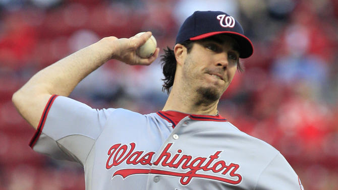 Washington Nationals starting pitcher Dan Haren throws to the Cincinnati Reds in the first inning of a baseball game, Friday, April 5, 2013, in Cincinnati. (AP Photo/Al Behrman)
