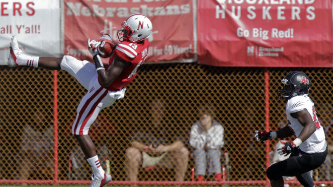 Nebraska's P.J. Smith, left, intercepts a pass intended for Arkansas State's David Oku during the first half of an NCAA college football game, Saturday, Sept. 15, 2012, in Lincoln, Neb. (AP Photo/Nati Harnik)