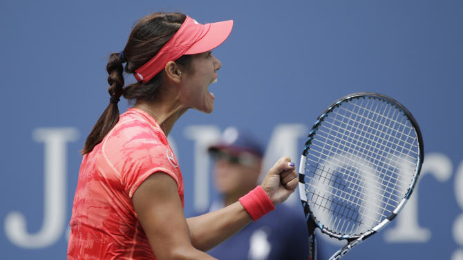 Li Na of China reacts to her husband and coach after beating Laura Robson of Great Britain during the third round of the 2013 U.S. Open tennis tournament, Friday, Aug. 30, 2013, in New York. (AP Photo/David Goldman)