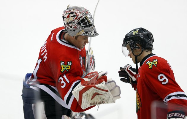 Portland Winterhawks' Carruth celebrates with De Leo after they defeated the Saskatoon Blades during the Memorial Cup Canadian Junior Hockey Championships in Saskatoon.