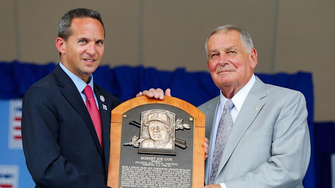 Inductee Bobby Cox (L) poses for a photograph with his plaque with Baseball Hall of Fame president Jeff Idelson at Clark Sports Center during the Baseball Hall of Fame induction ceremony on July 27, 2014 in Cooperstown, New York