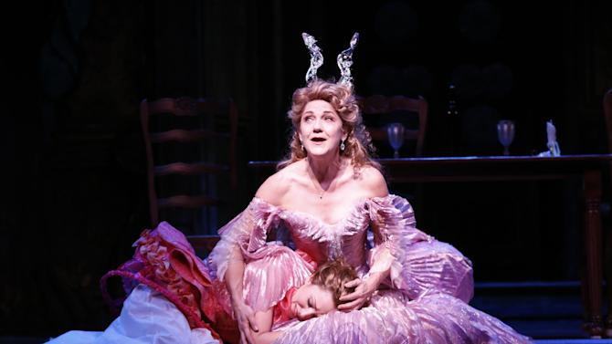 """This theater image released by Sam Rudy Media Relations shows Laura Osnes as Cinderella, left, and  Victoria Clark, as her Fairy Godmother, during a performance of """"Rodgers + Hammerstein's Cinderella on Broadway."""" (AP Photo/Sam Rudy Media Relations, Carol Rosegg)"""