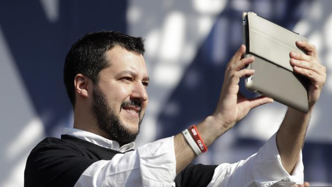 Northern League party leader Matteo Salvini takes a picture with a tablet during a rally downtown Rome