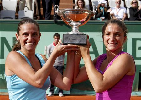 Errani and Vinci of Italy pose with their trophy after winning their women's doubles final against Kirilenko of Russia and teammate Petrova at the French Open tennis tournament in Paris