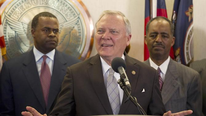 Georgia Gov. Nathan Deal speaks during a news conference Thursday, March 7, 2013, at which officials announced that financing terms have been reached for the Atlanta Falcons' proposal to build a new $1 billion stadium, keeping the NFL football team's home games in the city's downtown. (AP Photo/Todd Kirkland)