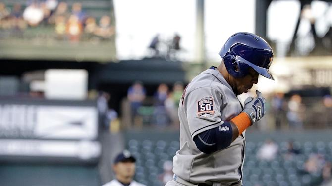 Houston Astros' Luis Valbuena, right, heads home on his home run as Seattle Mariners starting pitcher Hisashi Iwakuma looks on in the first inning of a baseball game Monday, April 20, 2015, in Seattle. (AP Photo/Elaine Thompson)