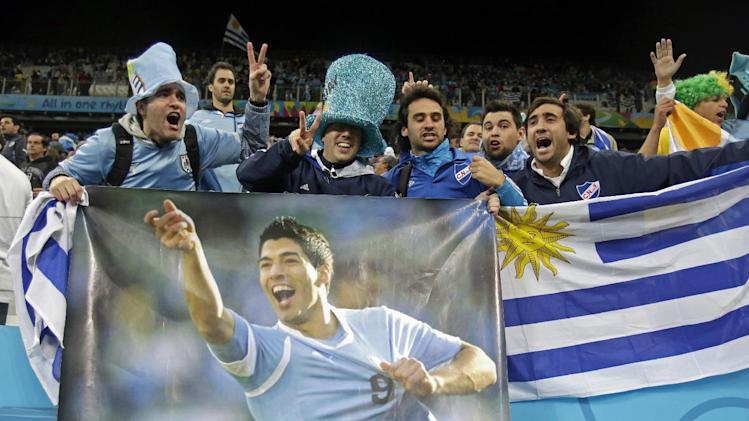 Uruguay fans celebrate after the group D World Cup soccer match between Uruguay and England at the Itaquerao Stadium in Sao Paulo, Brazil, Thursday, June 19, 2014. Uruguay won the match 2-1