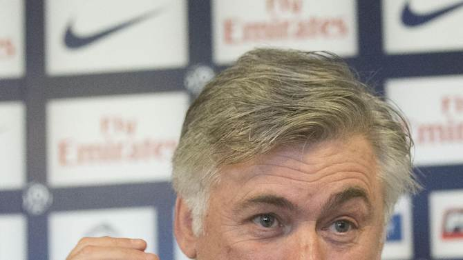 Paris Saint Germain coach, Carlo Ancelotti, gestures as he speaks to the media during a press conference in Saint-Germain-en-Laye,  France Saturday, Feb. 16, 2013. David Beckham will have to wait at least one more week to make his debut for the French club after coach Carlo Ancelotti ruled him out of Sunday's match against Sochaux. (AP Photo/Michel Euler)