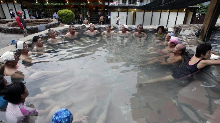 People enjoy themselves at the Beitou Open-Air Public Hot Springs in Taipei