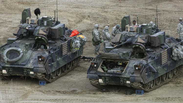 U.S. Army soldiers prepare for an exercise during their annual military drills with South Korea in Yeoncheon, South Korea, near the border with North Korea, Tuesday, April 9, 2013. North Korea has unleashed a flurry of war threats and provocations over U.N. sanctions for its last nuclear test, and over the ongoing U.S.-South Korean military drills, which the allies say are routine but Pyongyang says is a preparation for a northward invasion.  (AP Photo/Ahn Young-joon)