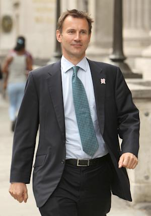 Culture Secretary Jeremy Hunt, walks to the House of Commons, in Westminster, central London, Monday July 11, 2011.  In a statement in the House of Commons Hunt said he was referring News Corporation's bid to buy the remainder of shares in BSkyB to the Competition Commission with immediate effect.(AP Photo/ Dominic Lipinski/PA)