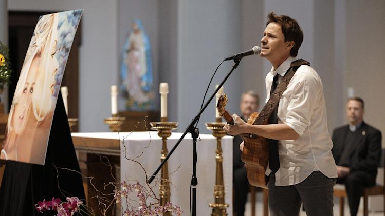 Bryan White performs during a memorial service for fellow country singer Mindy McCready on Wednesday, March 6, 2013, in Nashville, Tenn. McCready committed suicide Feb. 17 in Heber Springs, Ark. Old friends and family members spoke about her difficulties and triumphs during the hour-long remembrance Wednesday at the Cathedral of the Incarnation. (AP Photo/Mark Humphrey)