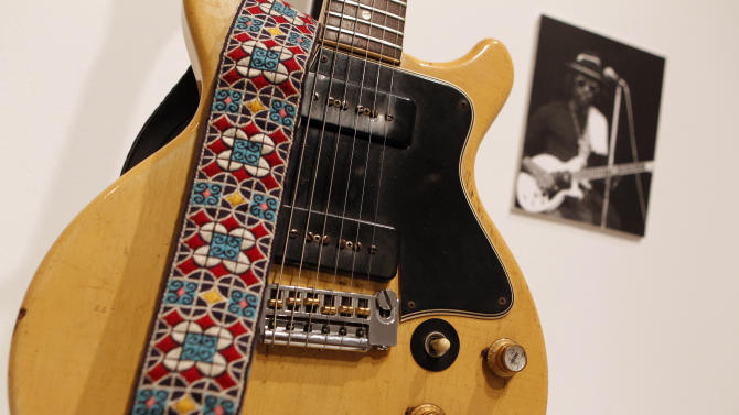 A 1960 Gibson Les Paul Special, formerly owned by reggae musician Peter Tosh, from the guitar collection of actor Richard Gere is displayed at Christie's, Thursday, Oct. 6, 2011 in New York.  The collection includes over 100 vintage American guitars and amplifiers and will be auctioned on Tuesday, Oct. 11, 2011. (AP Photo/Jason DeCrow)