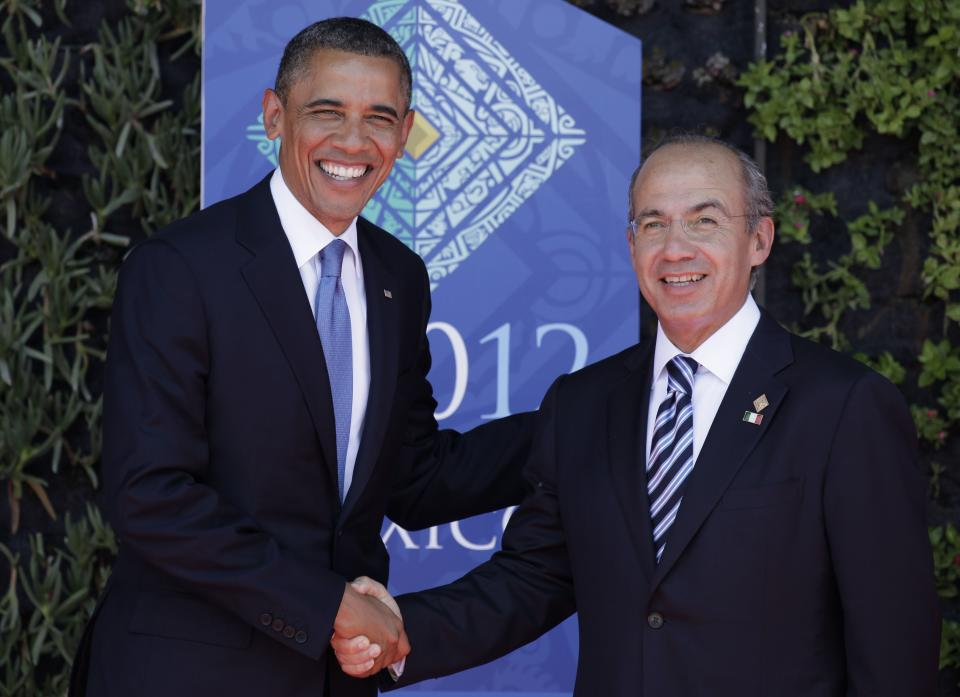 President Barack Obama, left, greets Mexico's President Felipe Calderon as they pose for pictures during the opening ceremony of the G-20 Summit in Los Cabos, Mexico, Monday, June 18, 2012. (AP Photo/Eduardo Verdugo)