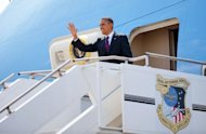 US President Barack Obama steps off Air Force One upon arrival at Naval Air Station Norfolk in Norfolk, Virginia. Obama is in Norfolk to attend a campaign rally at the Norfolk University