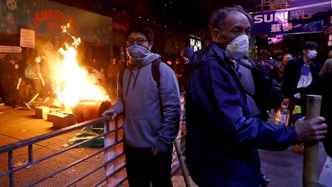 Protesters set fire at a junction at Mongkok shopping district in Hong Kong