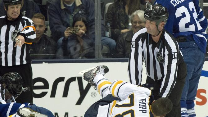 Linesman Derek Nansen (70) levels Buffalo Sabres Corey Tropp during an altercation against the Toronto Maple Leafs during second period NHL pre-season action in Toronto on Sunday, Sept. 22, 2013