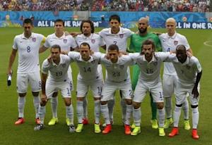 U.S. national soccer team players huddle together before the start of their 2014 World Cup Group G soccer match against Germany at the Pernambuco arena in Recife