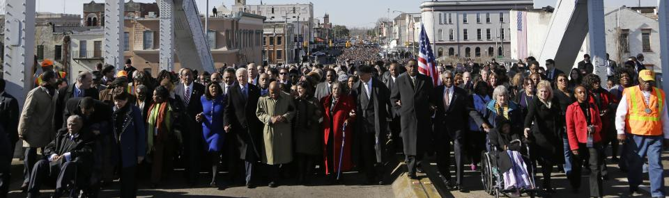 Vice President Joe Biden and other lawmakers lead a group across the Edmund Pettus Bridge in Selma, Ala., Sunday, March 3, 2013. They were commemorating the 48th anniversary of Bloody Sunday, when police officers beat marchers when they crossed the bridge on a march from Selma to Montgomery. (AP Photo/Dave Martin)
