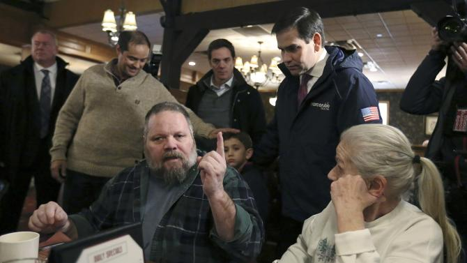 U.S. Republican presidential candidate Rubio is confronted by gay man on issues of gay marriage while visiting The Puritan restaurant in Manchester, New Hampshire