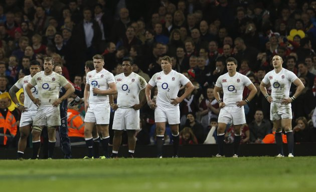 England players react after a Wales conversion during their Six Nations international rugby union match at the Millennium Stadium in Cardiff