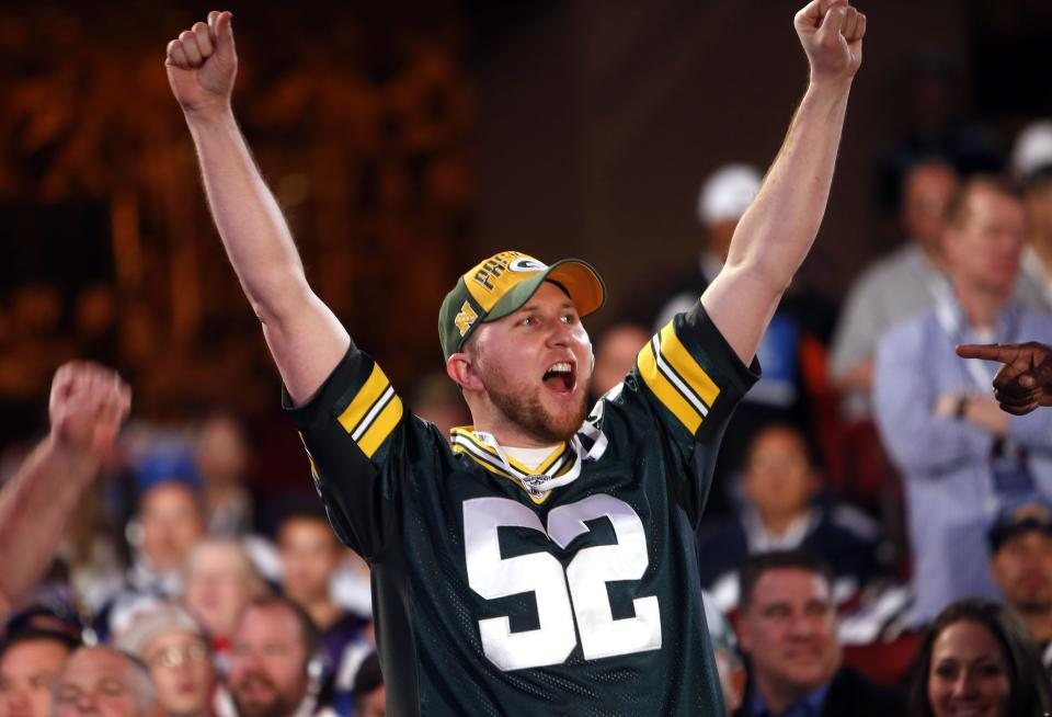 Green Bay Packers fan Joe Linna, of Ludington, Mich., celebrates after Green Bay selected Alabama's Eddie Lacy 61st overall in the second round of the NFL football draft on Friday, April 26, 2013, at Radio City Music Hall in New York. (AP Photo/Jason DeCrow)