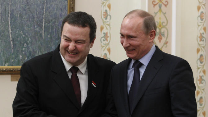 Russian President Vladimir Putin, right, shakes hands with Serbian Prime Minister Ivica Dacic during a meeting in the Novo-Ogaryovo residence outside Moscow, Wednesday, April 10, 2013. (AP Photo/Sergei Karpukhin, Pool)