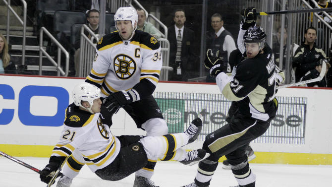 Pittsburgh Penguins' Evgeni Malkin (71) knocks Boston Bruins' Andrew Ference (21) into Bruins' Zdeno Chara (33) during the second period  of an NHL hockey game in Pittsburgh, Sunday, March 11, 2012. (AP Photo/Gene J. Puskar)