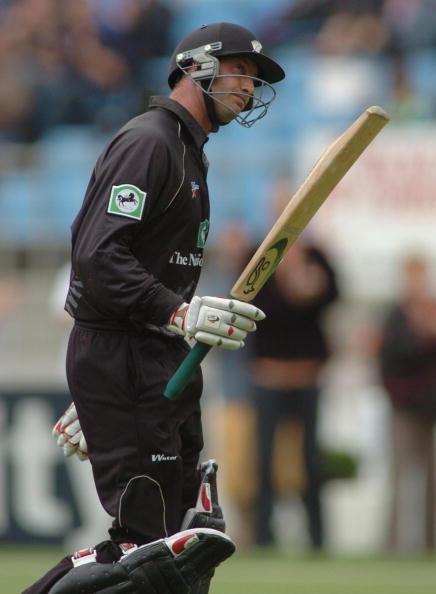 New Zealand's Chris Harris lifts his bat following