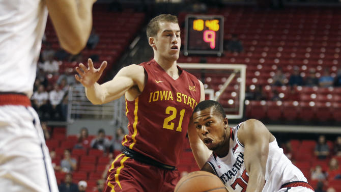 Texas Tech guard Toddrick Gotcher passes to a teammate defended by Iowa State guard Matt Thomas during the first half of an NCAA college basketball game, Wednesday, Feb. 10, 2016, in Lubbock, Texas. (AP Photo/Mark Rogers)