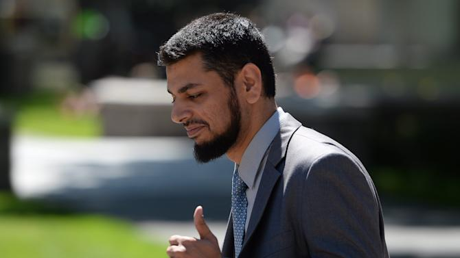 Khurram Syed Sher gives a thumbs up outside court in Ottawa, Ontario, on Tuesday, Aug. 19, 2014, after he was found not guilty of conspiring to facilitate terrorism. (AP Photo/The Canadian Press, Sean Kilpatrick)