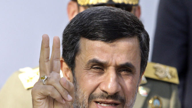 FILE - In this Sept. 1, 2012  file photo, Iranian President Mahmoud Ahmadinejad flashes a victory sign in Tehran, Iran. With the Iraq war over and Afghanistan winding down, Iran is the most likely place for a new U.S. military conflict. Despite unprecedented global sanctions, Iran's nuclear program is advancing. The United States and other Western nations fear the Islamic republic is determined to develop nuclear weapons and fundamentally reshape the balance of power in the Middle East, while posing a grave threat to Israel. Iran insists its program is solely designed for peaceful energy and medical research purposes.   (AP Photo/Vahid Salemi, File)