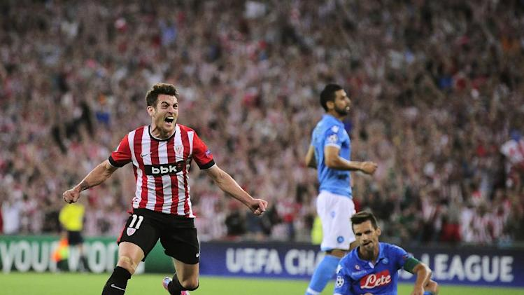 Athletic Bilbao's Ibai Gomez, left, celebrates his goal against SSC Napoli  during their Champions League playoff second leg soccer match, at San Mames stadium in Bilbao, northern Spain, Wednesday, Aug. 27, 2014.  Athletic Bilbao won 3-1