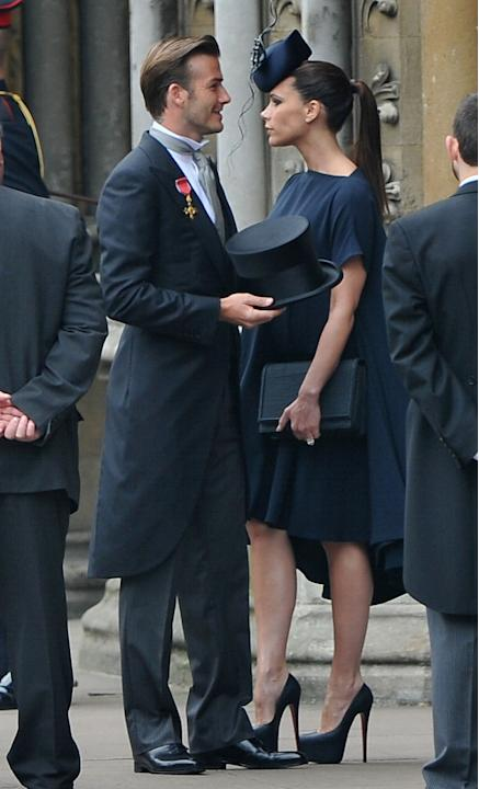 David and Victoria Beckham in theatrical hats