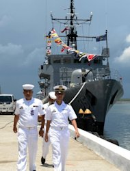 "Philippine navy personnel walk past a warship anchored at Fort San Felipe, on May 21, 2013. Philippine President Benigno Aquino has announced a $1.8-billion military upgrade to help defend his country's maritime territory against ""bullies"", amid an ever-worsening dispute with China"