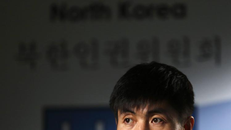 Human rights activist Shin Dong-hyuk speaks during a Reuters interview in Washington