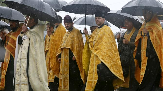 Clergymen take part in a procession marking 1,027th anniversary of Christianisation of Kievan Rus' in Kiev