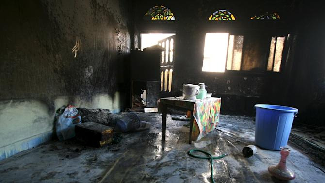 The burnt interior of a house is seen after a fuel truck was set ablaze in front of the house during clashes between Houthis and fighters of the Popular Resistance Committees in Yemen's southwestern city of Taiz